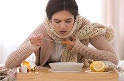 Sick,Young,Woman,Eating,Soup,To,Cure,Flu,At,Home