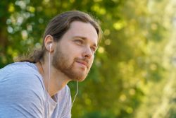 Portrait,Of,Young,Handsome,Bearded,Man,In,Earphones,Resting,After